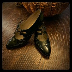 Salvatore Ferragamo patent leather Mary Janes.